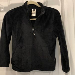 Fuzzy North Face half zip pull over